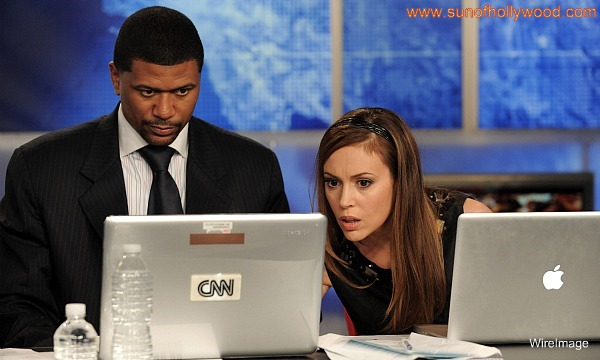 Jalen Rose And Alissa Milano look up tabloid headlines... Hopefully not Jalen's