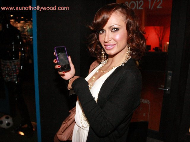 Exclusive Photo: Karina Smirnoff and her iPhone 4 will be appearing at a newsstand near you... Both without their cell phone covers