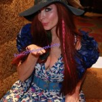 Phoebe Price Blows Jerry Buss a SunOfHollywood.com sprinkled Kiss