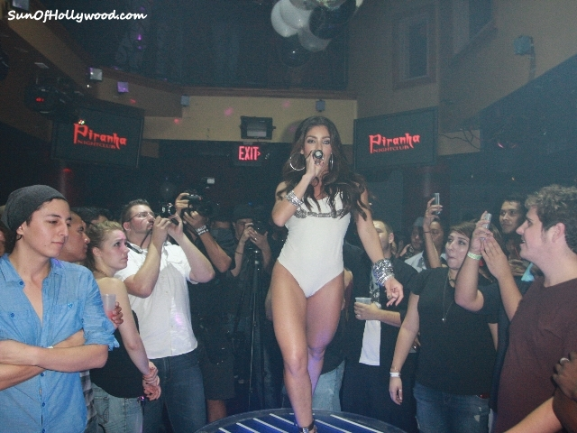 The Crowd Sings Her Praises... When It's Melissa Molinaro Under Roofs That She Raises