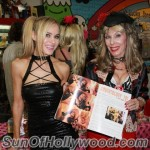 "Paula Labaredas and Dr. Susan Block with the July Issue of ""Girls And Corpses"" showing us what Dr. Suzy's Made Of"