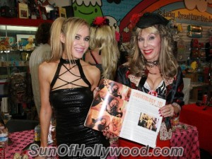 """Paula Labaredas and Dr. Susan Block with the July Issue of """"Girls And Corpses"""" showing us what Dr. Suzy's Made Of"""