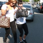 Kim Kardashian frantically searches through her purse for her car keys, to make a quick getaway