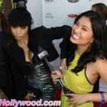 A Slight Inv-Asian Of Personal Space... Bai-Ling Grabs The Boob Of Xixi Yang From PopStopTV.com .. Makes For Interesting Interviews